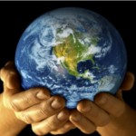 Hands holding earth photo